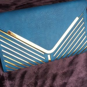 Large envelope clutch with strap